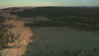 Aerial Shot Of Bryce Canyon National Park Over Green Forest