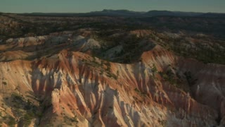 Aerial Shot Of Bryce Canyon National Park Over Low Hills