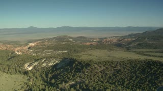 Aerial Shot Of Bryce Canyon National Park Over Open High Desert