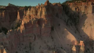 Aerial Shot Of Bryce Canyon National Park Passing Cliff Face With Shadow
