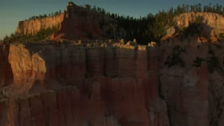 Aerial Shot Of Bryce Canyon National Park Passing Close To Red Cliffs