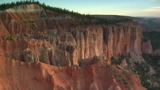 Aerial Shot Of Bryce Canyon National Park Passing Low Over Cliffs