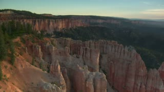 Aerial Shot Of Bryce Canyon National Park Passing Low Over Trees