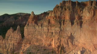 Aerial Shot Of Bryce Canyon National Park Passing Sharp Red Spires