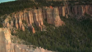 Aerial Shot Of Bryce Canyon National Park Passing White Cliff