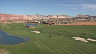 Aerial Shot Of Golfers On Desert Course