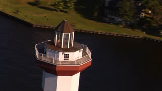 Aerial Shot Of Lighthouse With Sparkling Water With Zoom Out