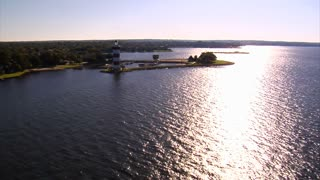 Aerial Shot Of Lighthouse With Sparkling Water