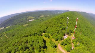 Aerial shot of mountain top communication towers