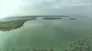Aerial Shot of Ocean and Island Off Coast of Miami