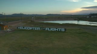 Aerial Shot Of Scenic Helicopter Flights Sign