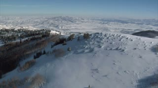 Aerial Shot Of Snowy Mountains And Meadows