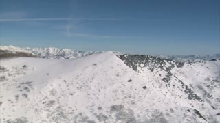 Aerial Shot Of Snowy Ridge And Mountains