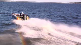 Aerial Shot Of Speed Boat From Behind