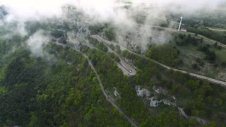 Aerial shot of the car traffic on a mountain serpentine road