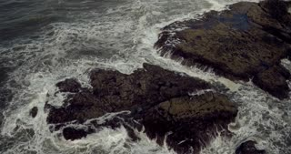Aerial Shot of the Waves flowing toward the Coast