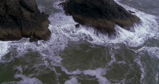 Aerial Shot of Waves Flowing toward the Beach