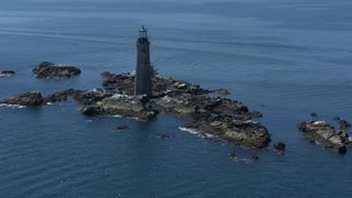Aerial Shot Over Lighthouse On Rocky Outcrop Of Boston Harbor