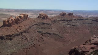 Aerial Shots Of Red Rock Desert Buttes And Sage Desert