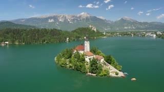 AERIAL: Stunning Bled lake island on sunny summer day