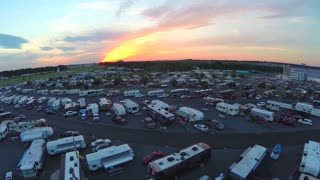 aerial sweep over trailer lot at race car event