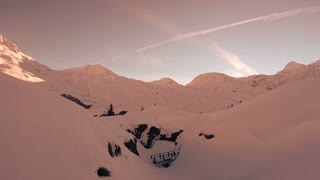 Aerial through snowy winter canyons