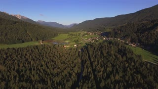 AERIAL: Urban mountain valley with houses and roads