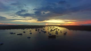 Aerial view of Bali at sunset. Popular summer beach in Indonesia with indian ocean and view on the bay with yachts