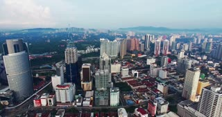 Aerial view of Kuala Lumpur city in Malaysia capital, tall buildings. Cinematic video of skyscrapers in big City