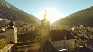 aerial view of romantic church building. sunset village town