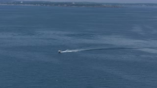 Aerial View Of Speed Boat And Lighthouse In Boston Harbor