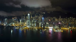 Aerial view over Hong Kong Island looking towards Victoria Peak showing the busy Victoria Harbour and Financial District of Central, Hong Kong, China, T/lapse