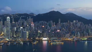Aerial view over Hong Kong Island towards Victoria Peak showing the busy Victoria Harbour and Financial District of Central, Hong Kong, China, T/lapse