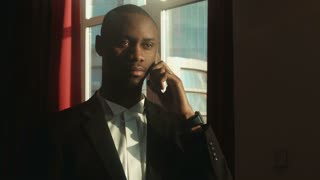 African, American businessman talking on the phone
