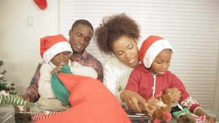 African American children looking through stocking gifts