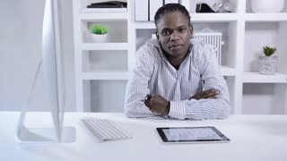 african american man working with tablet computer in home office