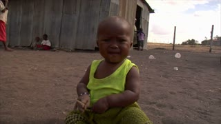 African Baby Sitting in the Dirt