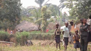 African Children With Train And Village In Distance