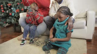 African family preparing Christmas lights