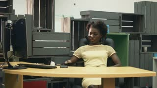 African female worker in office chair after workday using glasses of virtual reality