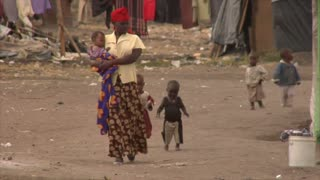 African Woman Followed by Kids on Street
