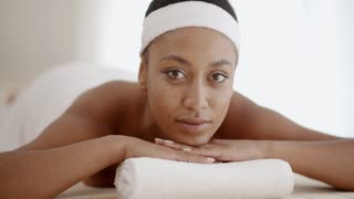 African Woman Laying On Spa Table