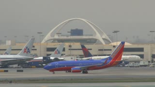 Airplane Moving To Terminal At LAX