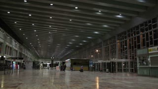 Airport hall with passengers.
