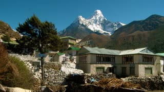 Ama Dablam Looming Over Buildings