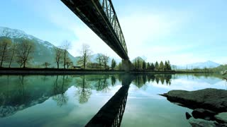 amazing landscape panorama. water reflection. bridge over lake