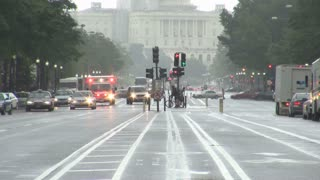 Ambulance Driving Up Rainy Street from Capitol 2