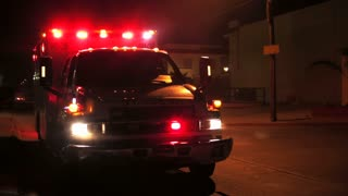 Ambulance illuminated in the dark