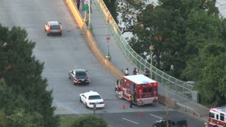 Ambulance Stopped on Bridge