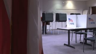 American Flag and Voting Booths